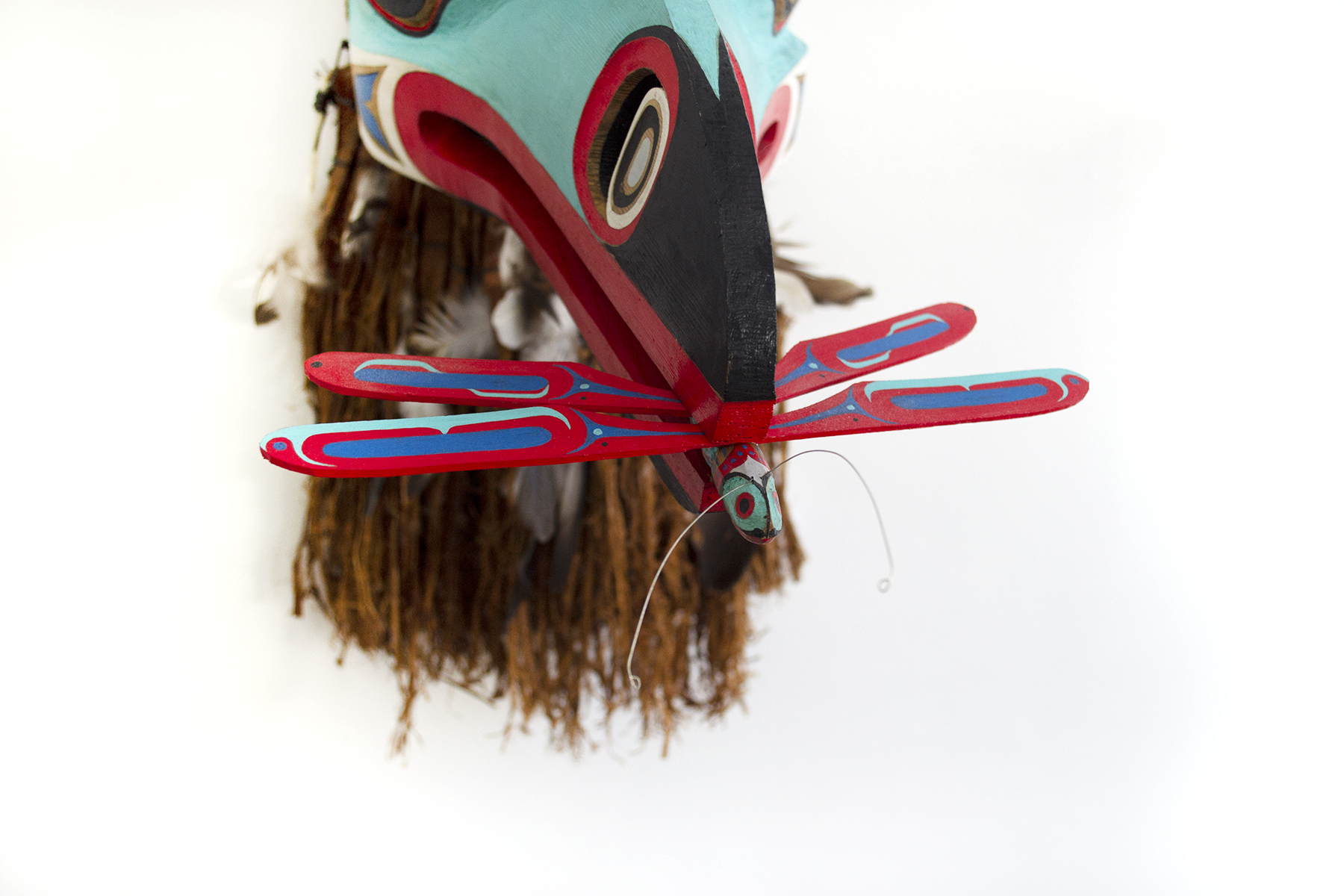 "Kingfisher (detail), 2015, Alan Hunt (Kwakwaka'wakw), Red cedar, acrylic, cedar bark, feathers, string, wire, 9"" x 31"" x 21"" (including cedar bark), $3,700"