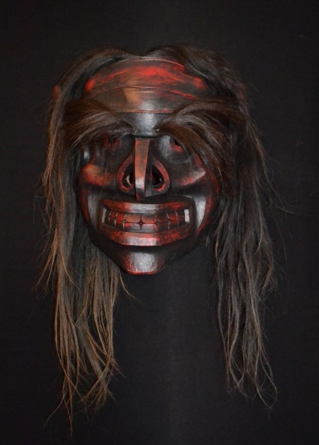 "Bookwus Mask, Beau Dick (Kwakwaka'wakw), Red cedar, acrylic paint, leather and horsehair, 25"" x 26.5"" x 16"", SOLD"