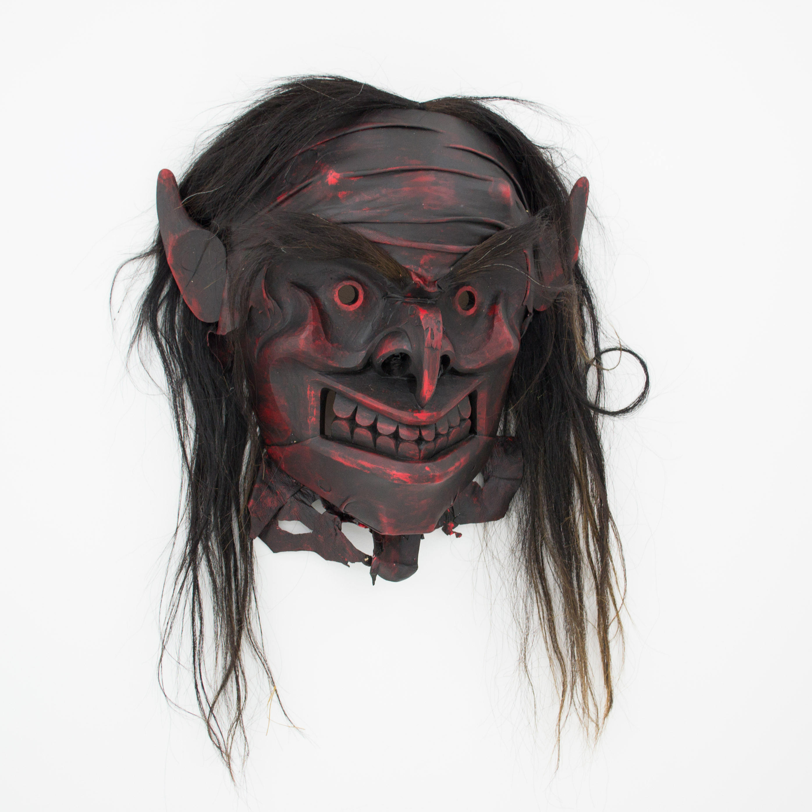 "Bookwus Mask, 2016, Beau Dick (Kwakwaka'wakw), Red cedar, acrylic paint, horsehair, deer hide, 25"" x 28"" x 12"""