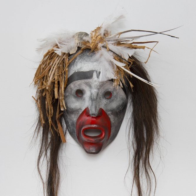 "Pookmis Ghost 1, Beau Dick (Kwakwaka'wakw), Red cedar, acrylic, horsehair, feathers, and graphite, 15"" x 30"" x 5"" (including hair), SOLD"