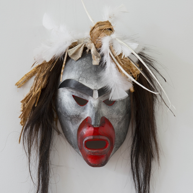 "Pookmis Ghost 2, Beau Dick (Kwakwaka'wakw), Red cedar, acrylic, horsehair, feathers, and graphite, 15"" x 45"" x 5"" (including hair and feathers), SOLD"