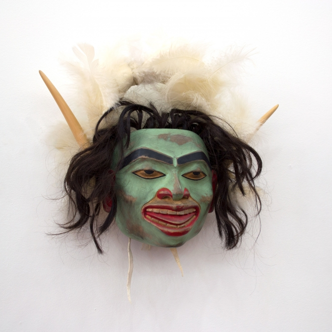 "Shaman Headdress (2010), Beau Dick (Kwakwaka'wakw), Red cedar, acrylic, feathers, human hair, and hide, 14"" x 14"" x 4"""