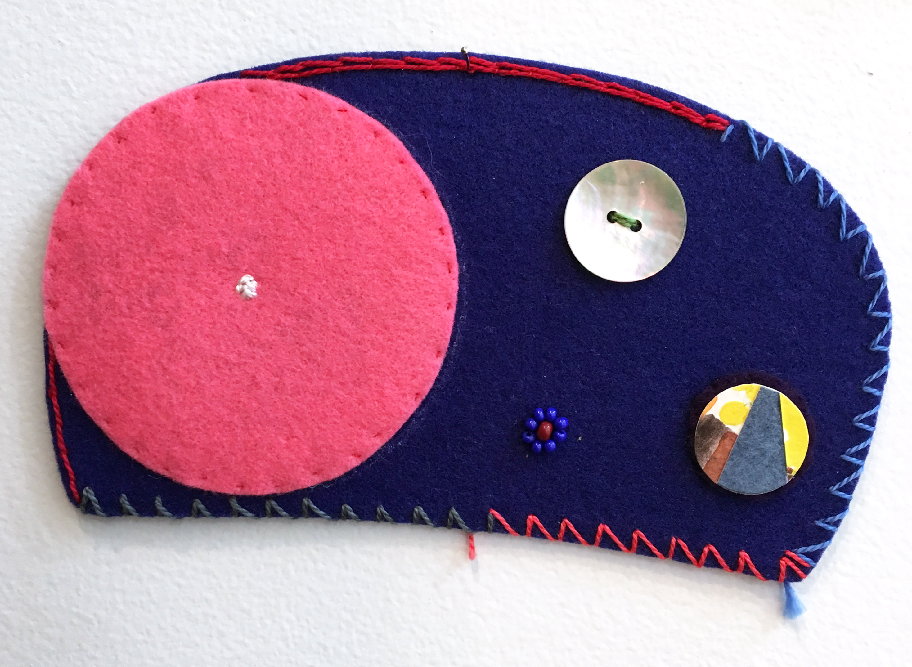 Ovoid Felts, Charlene Vickers (Anishnabe), Watercolour, paper, shell buttons, glass beads on felt with embroidery edges, $600
