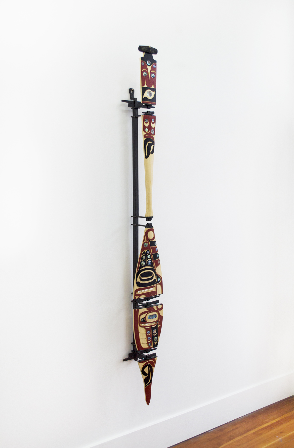 "Hummingbird Paddle (Deconstructed), 2018, Moy Sutherland (Nuu-chah-nulth), Yellow cedar, acrylic, abalone, operculum, iron, 60"" x 8"" x 6.5"", $7,600"