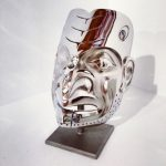 "Predator Cannibal Mask by Robin Lovelace cast stainless steel with abalone edition/19 13"" x 9"" x 7"" $28,000"