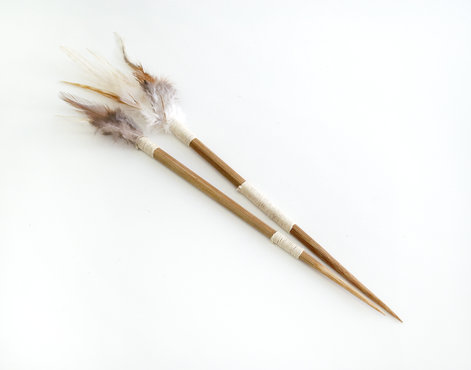 "Darts (2), 2018, Carlos Colín, Chopsticks, thread, feathers, 13"" (L), SOLD"
