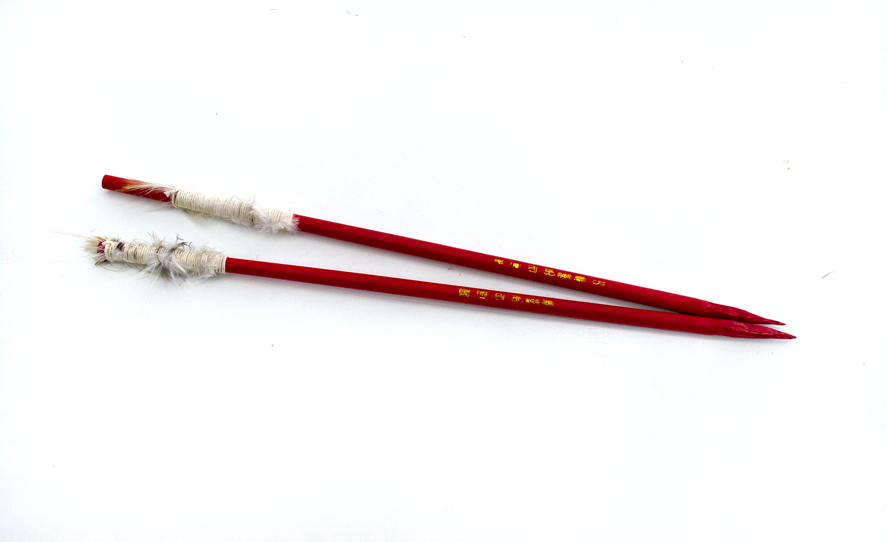 "Darts (8), 2018, Carlos Colín, Chopsticks, thread, feathers, 9.5"" (L), $200"