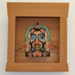 "Frontlet with bentwood box frame by Gary Peterson Red cedar, yellow cedar, alder, copper, abalone and acrylic paint. 16 1/2"" x 15"" (box) 6 1/4"" x 8 1/2 (frontlet) $8,000"