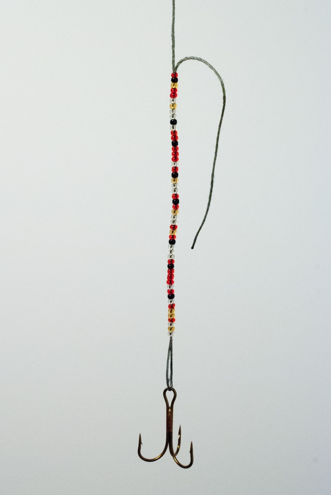 "Beaded Lure (2015), Couzyn van Heuvelen (Inuk), Glass beads, fish hook, thread, brass, 6"" x 1"" x 48"", $250"