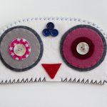 Ovoid Felts, Charlene Vickers (Anishnabe), Watercolour, paper, shell buttons, glass beads on felt with embroidery edges, POR