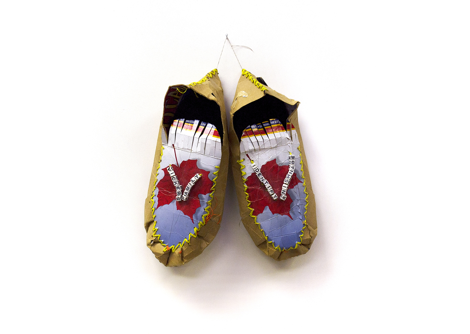 """I am Canadian Moccasin, 2000, Charlene Vickers (Anishnabe), Beer box paper, faux fur, synthetic lacing, letter beads, 12"""" x 9.5"""" x 3.5"""", $1,200"""