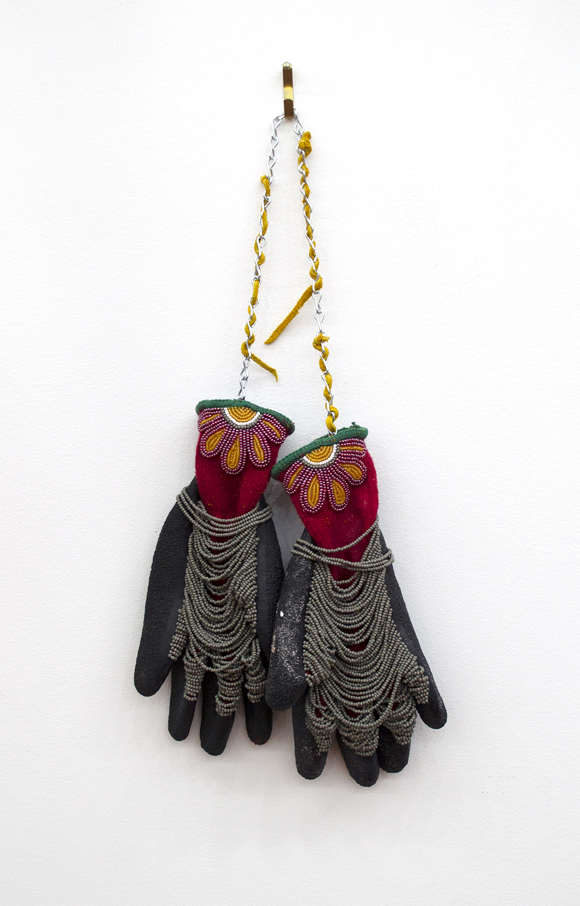 "Half Son Gloves, 2018, Audie Murray (Métis), Gloves, beads, leather, metal chain, 17"" x 8.5"" x 3"", SOLD"