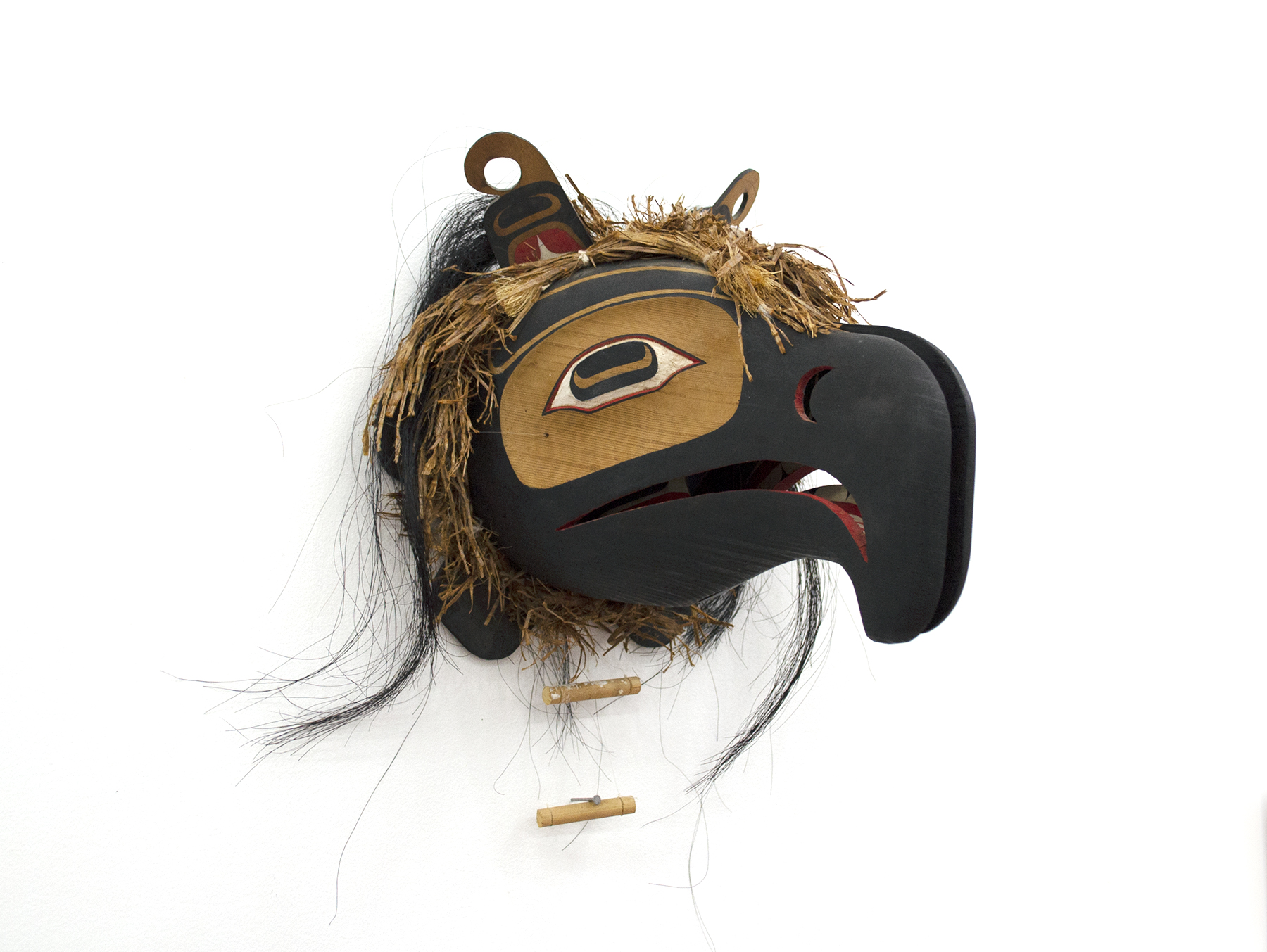 "Transformation Mask (closed), c. 1980, Beau Dick, Red cedar, acrylic, horsehair, fishing line, cedar bark, 11"" x 10"" x 11.5"" (closed); 11"" x 14"" x 15. 5"" (open), SOLD"