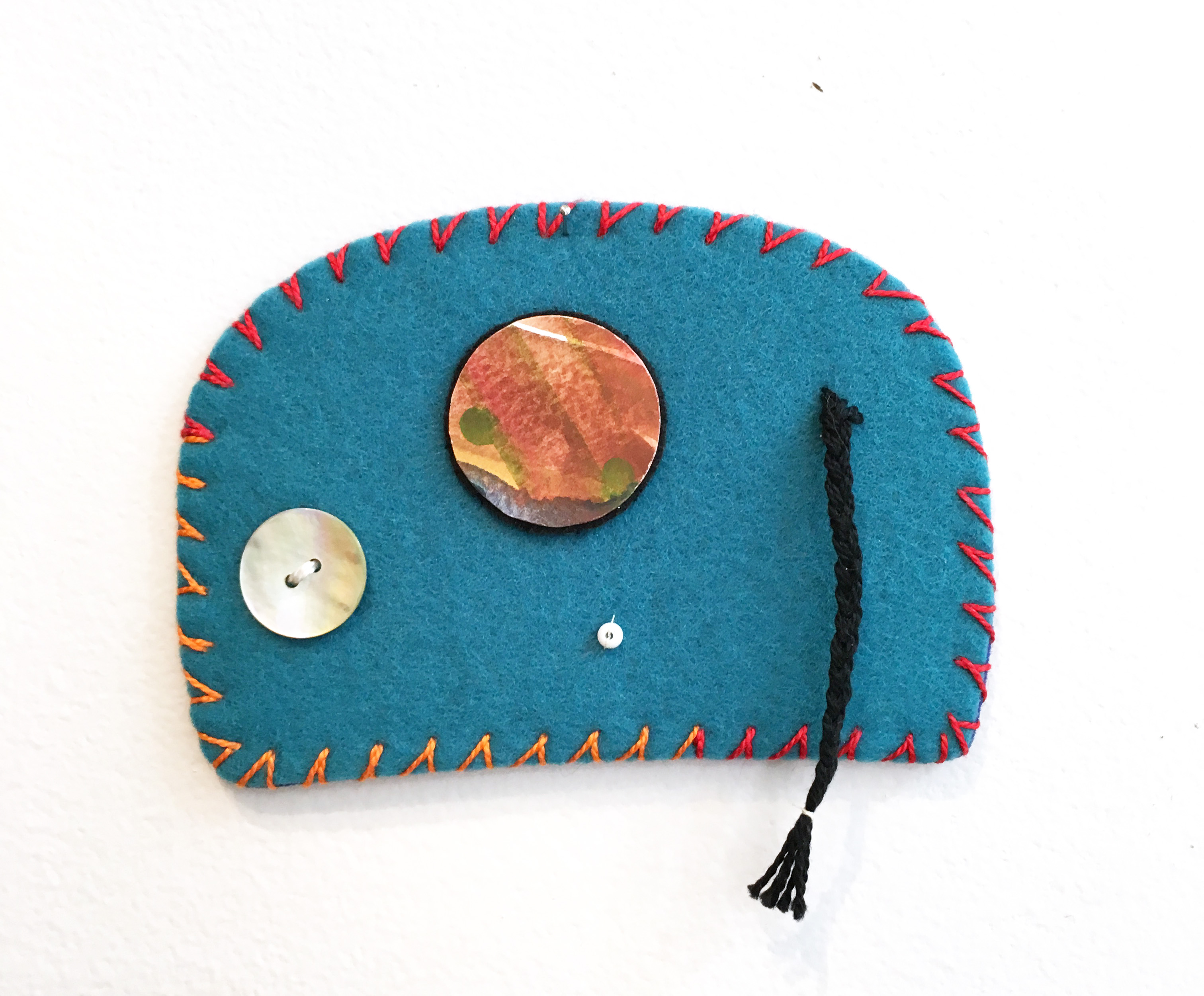 Ovoid Felts, Charlene Vickers (Anishnabe), Watercolour, paper, shell buttons, glass beads on felt with embroidery edges, $500