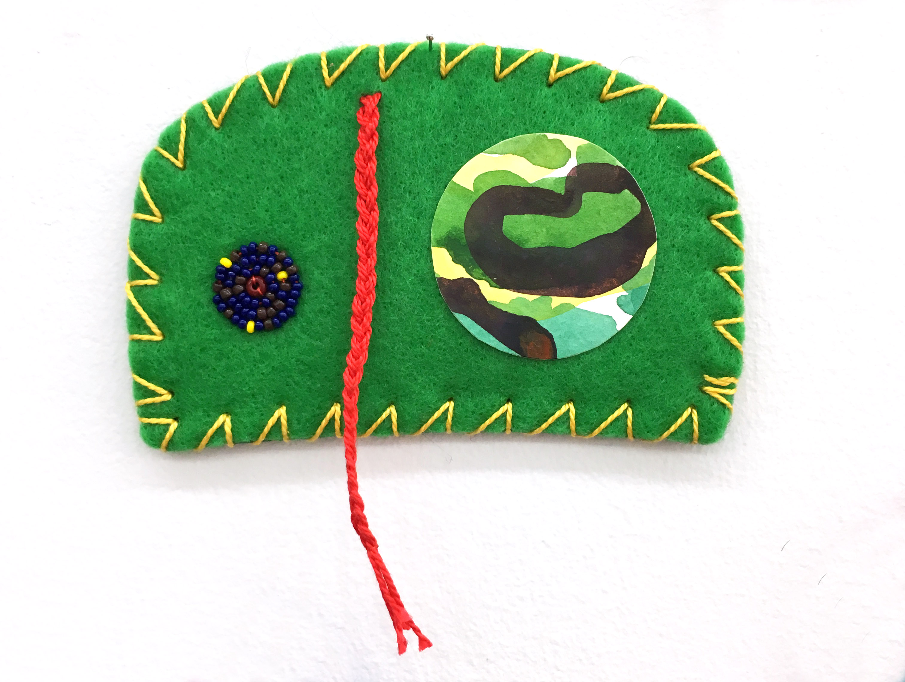 "Ovoid Felts, Charlene Vickers (Anishinabe), Watercolour, paper, shell buttons, glass beads on felt with embroidery edges, 4.5"" x 3"", SOLD"