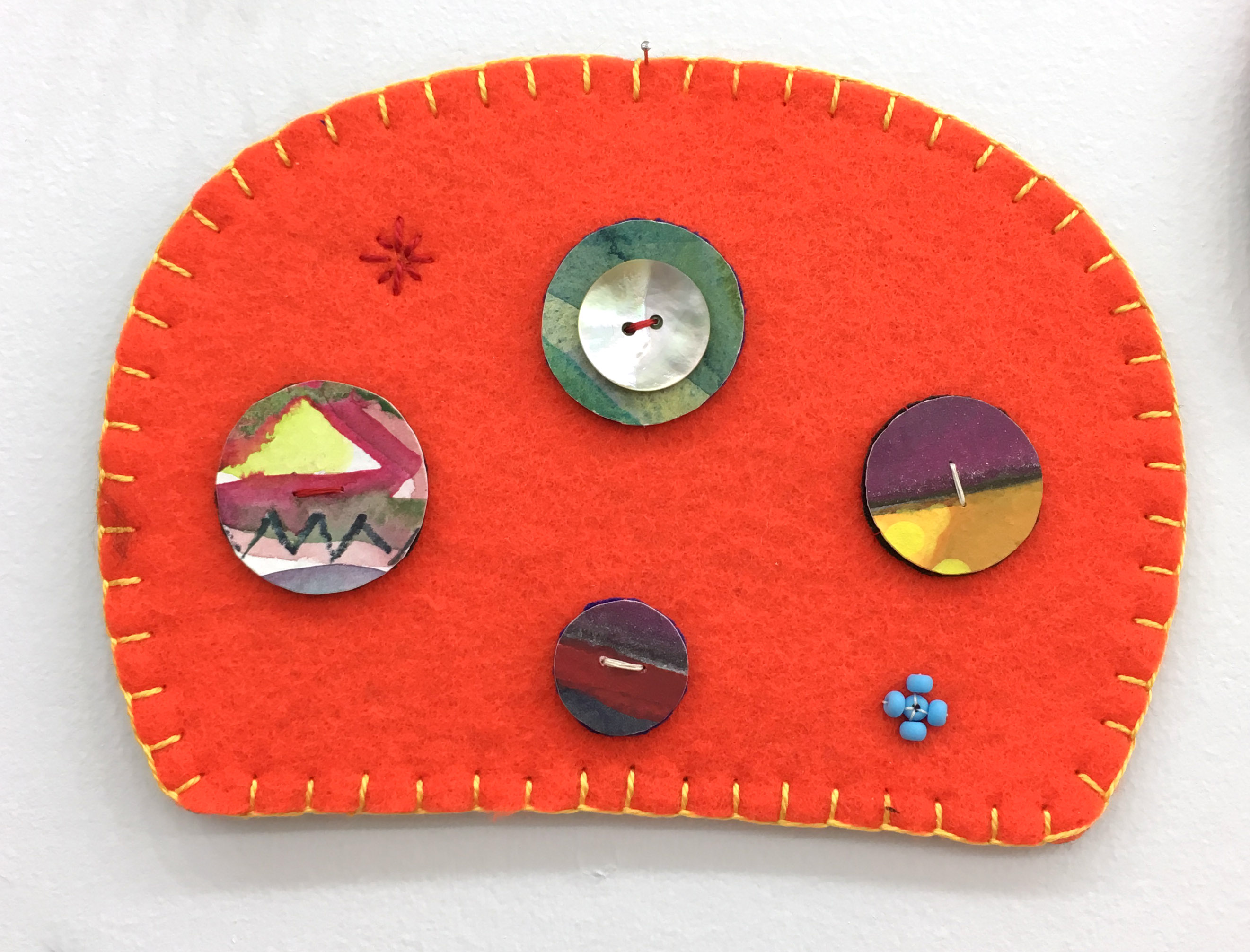 "Ovoid Felts, Charlene Vickers (Anishinabe), Watercolour, paper, shell buttons, glass beads on felt with embroidery edges, 6.5"" x 4.5"", SOLD"