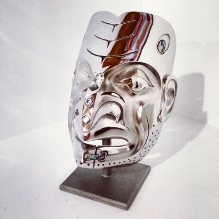 """Predator Cannibal Mask by Robin Lovelace cast stainless steel with abalone edition/19 13"""" x 9"""" x 7"""" $28,000"""