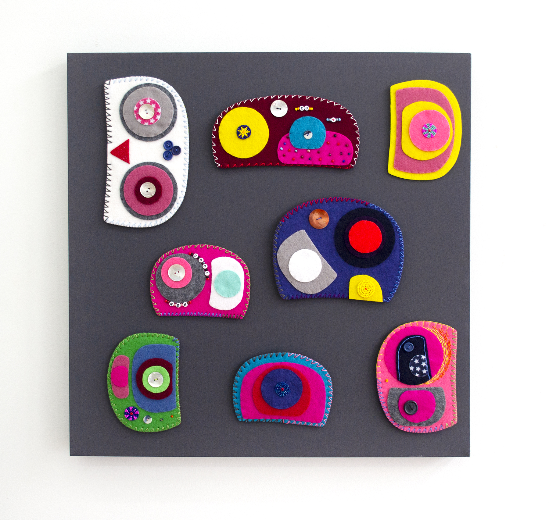 Ovoid Felts (grouping), Charlene Vickers (Anishnabe), Watercolour, paper, shell buttons, glass beads on felt with embroidery edges