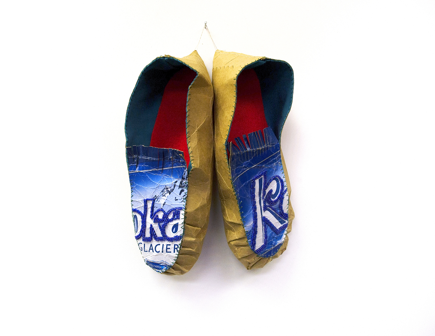 "Oka Moccasin, 2004, Charlene Vickers (Anishnabe), Beer box, glass beads, cotton fabric, felt, thread, 12"" x 9"" x 3.5"", $1,200"