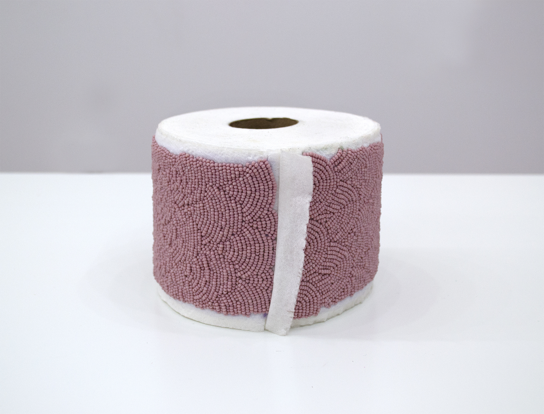 "T.P., 2018, Audie Murray (Métis), Toilet paper and seed beads, 4"" x 5"" x 5"", $9,000"
